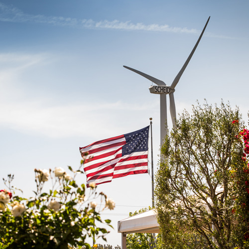 Scheid wind turbine shown with the American flag