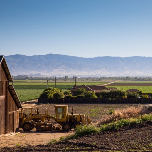 Farm tractor and barn at Scheid vineyards