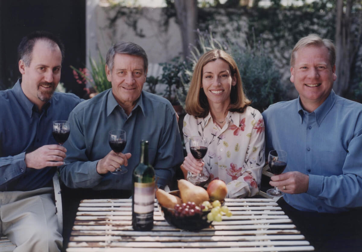 Gang of Four holding wine glasses